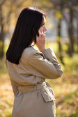Woman calling by mobile phone — Stock Photo
