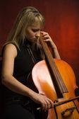 Woman musician with cello — Stock Photo