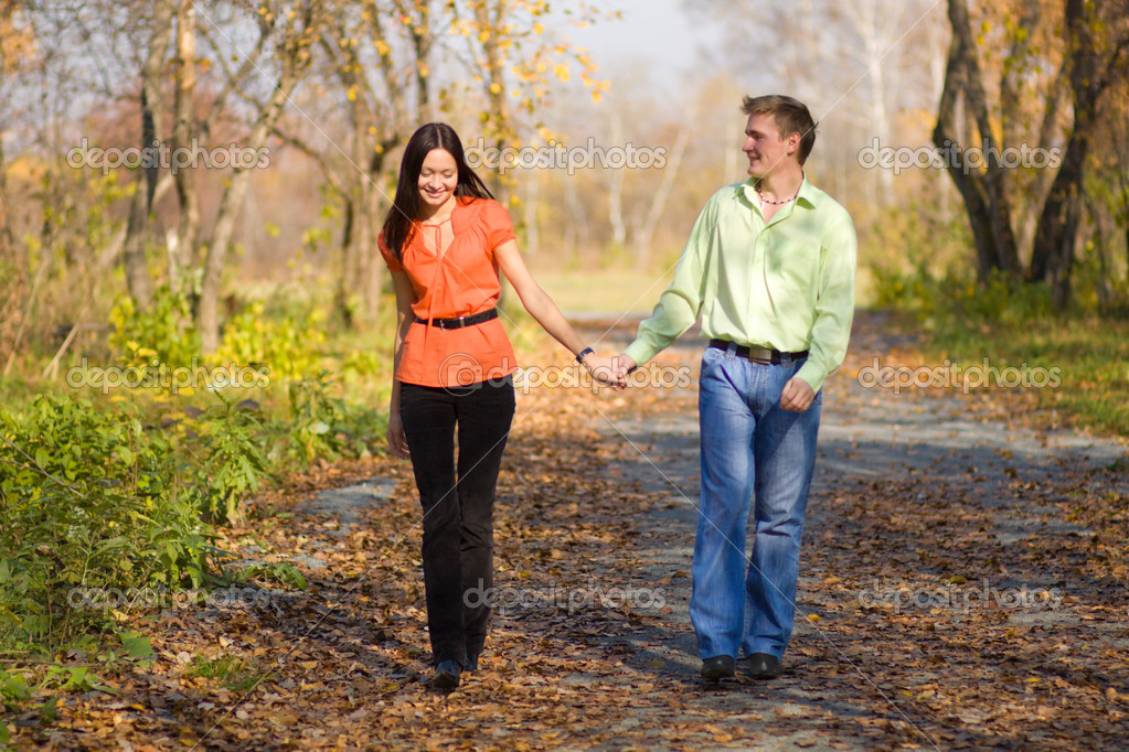 Young happy couple walking in the park - Stock ImageYoung Couple Walking In The Park