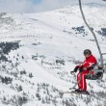 Skiers on a ski lift — Stock Photo