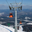 Ski lift to top of mountain - Stock Photo