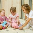 Stock Photo: Little girls playing together