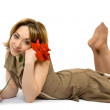 Girl lay on the floor with roses — Stock Photo
