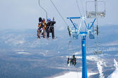 Skiers on a ski lift — Stock Photo