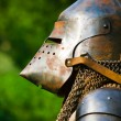 Man in knight's helmet - Stock Photo