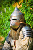 Man in knight's helmet — Stock Photo