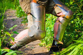 Feet in chivalrous protection — Stock Photo