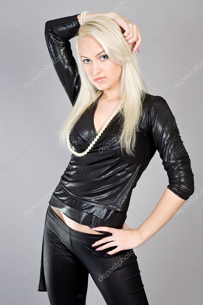Young beautiful blonde in a black club suit on a grey background — Stock Photo #2943456