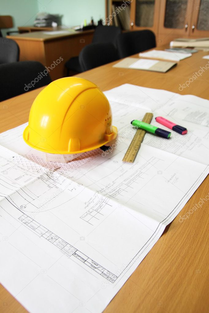 Desk, with the drawing laying on it, a helmet, a ruler and two felt-tip pens — Stock Photo #3284637