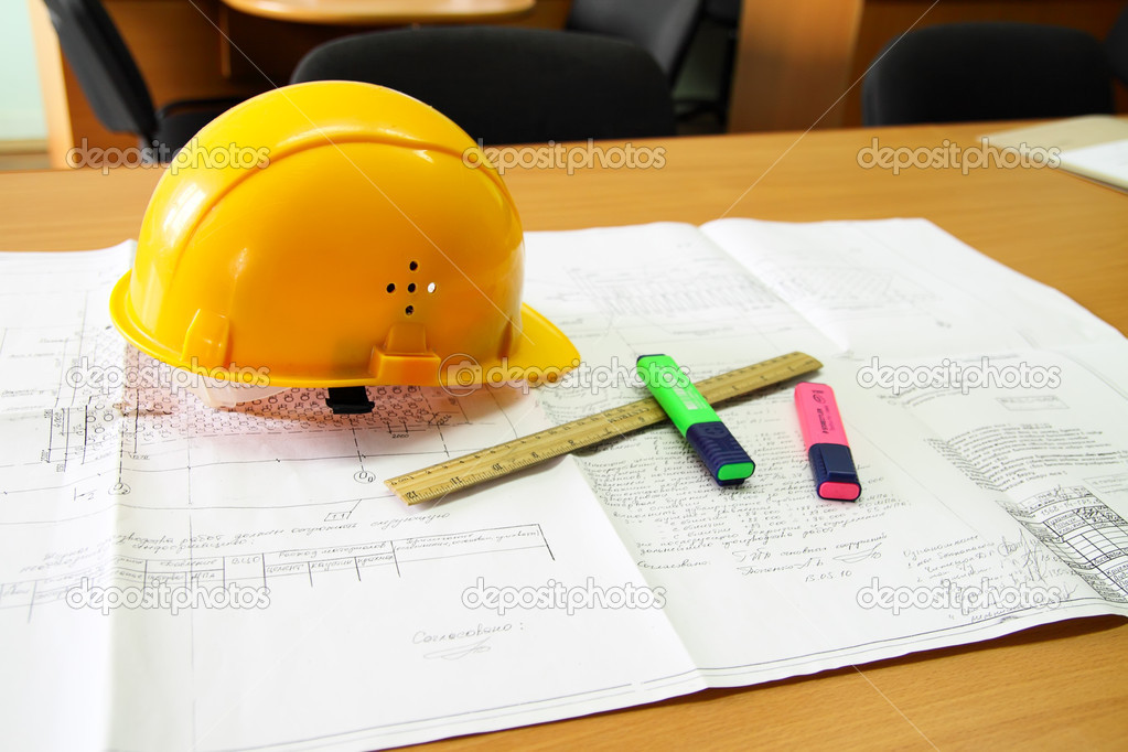 Desk, with the drawing laying on it, a helmet, a ruler and two felt-tip pens — Stock Photo #3284734