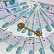 Russian money and the key — Stock Photo