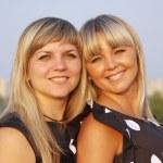 Two beautiful girls on nature — Stock Photo #3902288