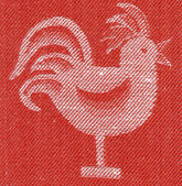 Stylised cock red fabric — Stock Photo