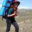 Happy backpacker woman in hat — Stock Photo