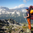 Hiker girl with backpack and ice-axe — Foto Stock
