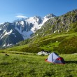 Mountaneer bivouac in mountains - Stock Photo