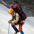 Hicker with backpack and ice-axe — Stock Photo