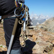 Hiker with climbing equipment - Stock Photo