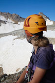 Hiker girl in orange helmet — Stock Photo