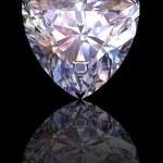 Diamond on glossy black background — Stock Photo