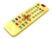 Golden universal remote control with colorful gems buttons — Stock Photo