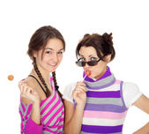 Attractive girls with lollipops — Stock Photo