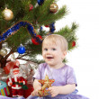 Baby girl under the Christmas tree — Stok fotoğraf