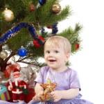 Baby girl under the Christmas tree — Stock Photo