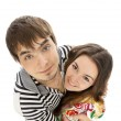 Smiling young couple in love isolated on white — Stock Photo