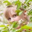 Girl - Spring. Portrait of a teenage girl in a flowering cherry — Stock Photo