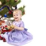Baby girl under the Christmas tree — Stock Photo #3509361