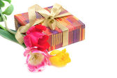 Gift box and a bouquet of tulips isolated on white — Stock Photo