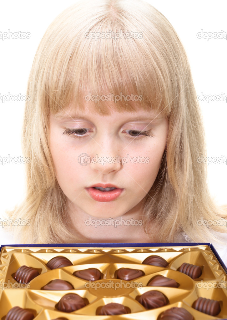 depositphotos 3669094 Cute teen girl with chocolate candies box isolated on white Happy laughing blonde teenage girl wearing braces. Royalty Free Stock Photo