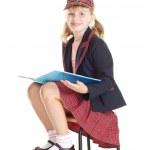 Teen girl in school uniform reading a book — Stock Photo #3753112