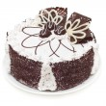 Beautifully decorated cake with white and dark chocolate isolate — Stock Photo