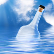 Bottle in water — Stock Photo