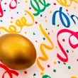 Golden egg in decoration - Stock Photo
