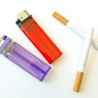 Two lighters and cigarettes — Stock Photo #2796232