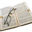 Old open book with glasses — Stock Photo