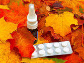 Autumn leaves and medicament — Stock Photo