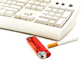 Keyboard, cigarette and lighter — Stock Photo
