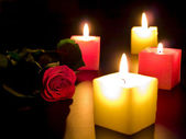 Rose with candles — Stock Photo