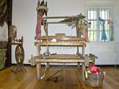 Old wooden loom in the center of the room — Stock Photo