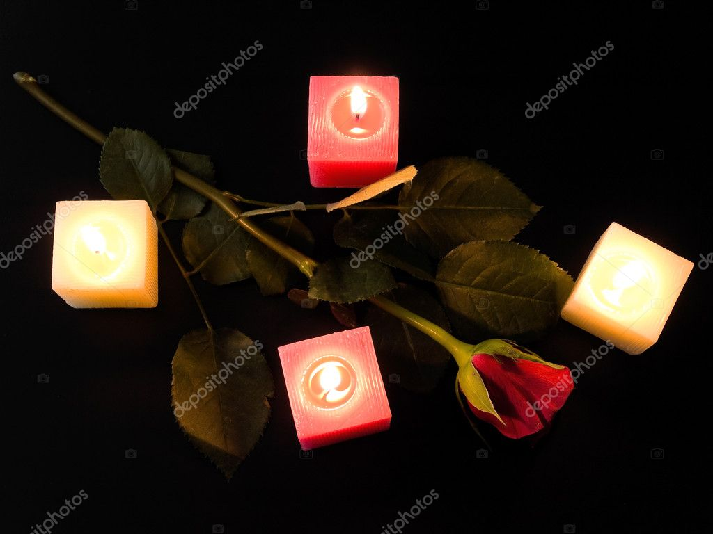 Red rose with four candles in the night — Stock Photo #2795687