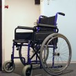 Wheelchair in the hospital - Stock Photo
