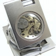 Clockwork under magnifier - Stock Photo
