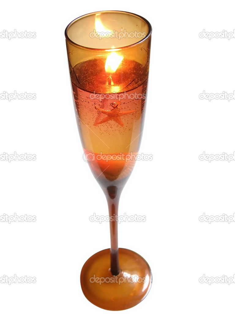 Candle in wineglass with sea star and shells    #2953979