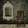Grunge interior with chair and vintage frame — Stock Photo #3262204