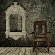 Grunge interior with chair and vintage frame - Stock Photo