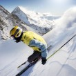 Stock Photo: Skier in high mountains